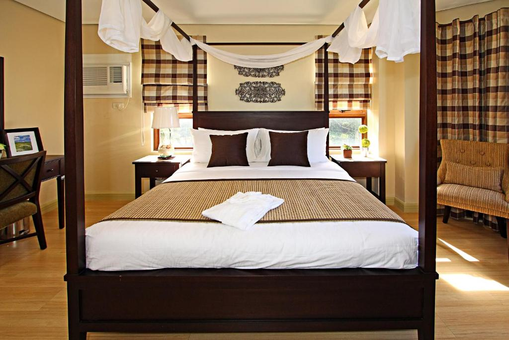 A bed or beds in a room at Crosswinds Resort Suites