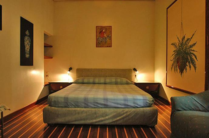 Letto o letti in una camera di Chiaia B&B