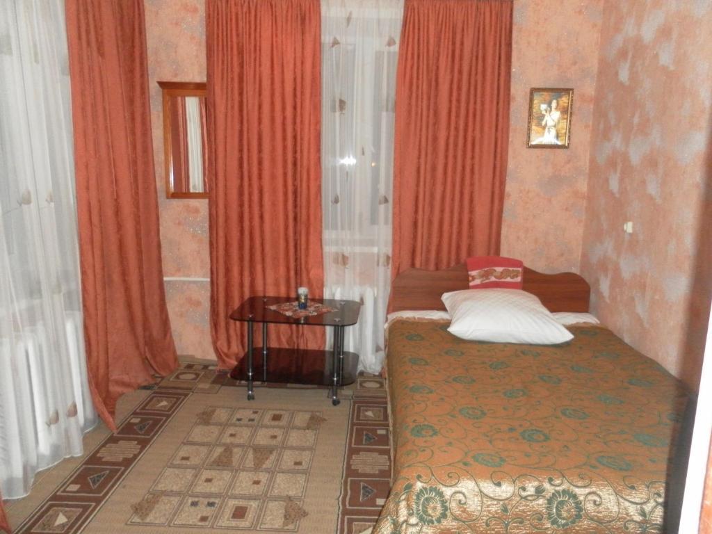 Кровать или кровати в номере Central'naya