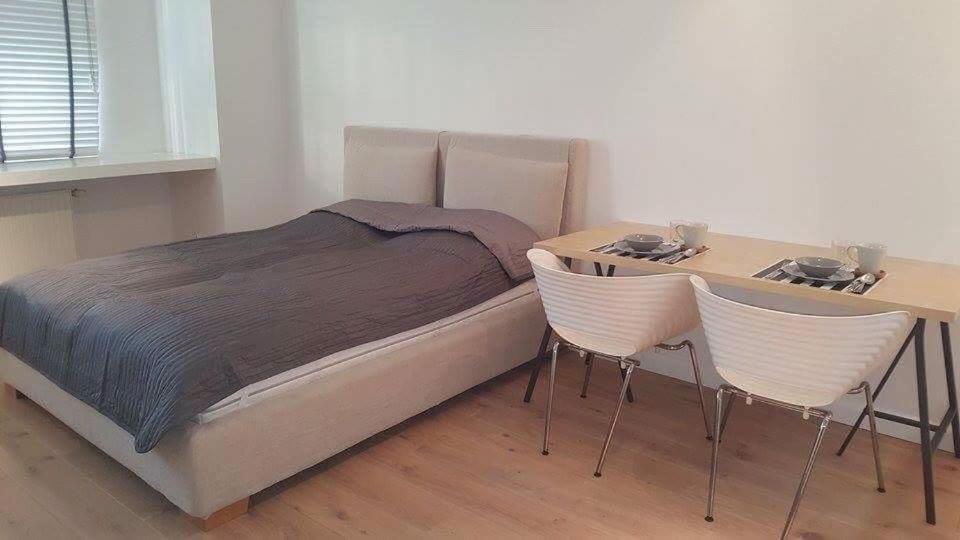 Łóżko lub łóżka w pokoju w obiekcie Apartament Trzy Gracje w Sopocie