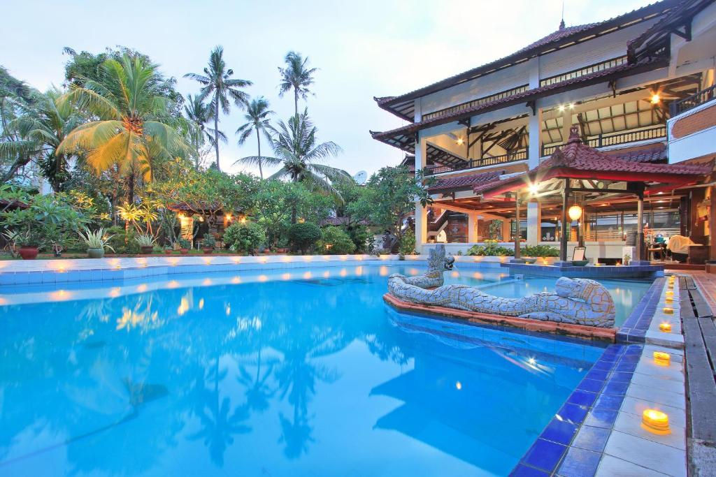 The swimming pool at or close to Puri Naga Beachfront Cottages