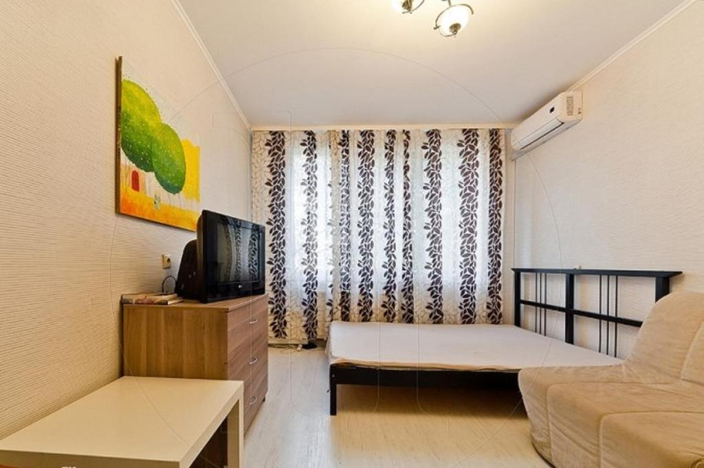 A bed or beds in a room at Apartments at Prospect Bol'shevikov 5