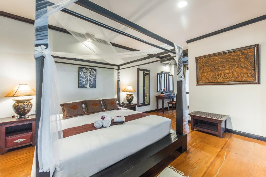 เตียงในห้องที่ กัซซัน ขุนตาน กอล์ฟ แอนด์ รีสอร์ท Gassan Khuntan Golf & Resort