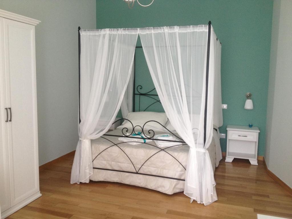 Letto o letti in una camera di Arco dolce Arco