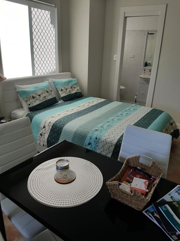 A bed or beds in a room at Bayview Studio