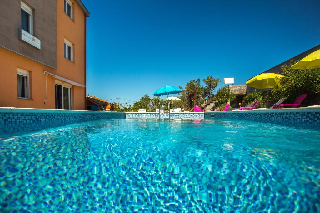 The swimming pool at or near Adriatic Star