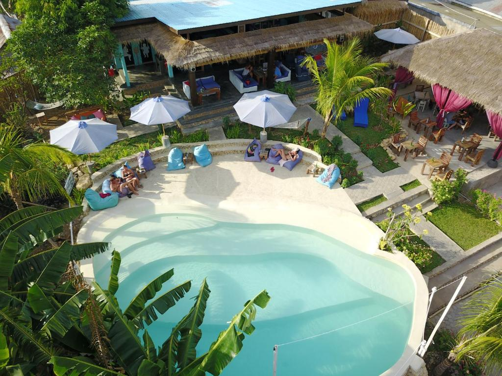 A view of the pool at Wae Molas Hotel or nearby