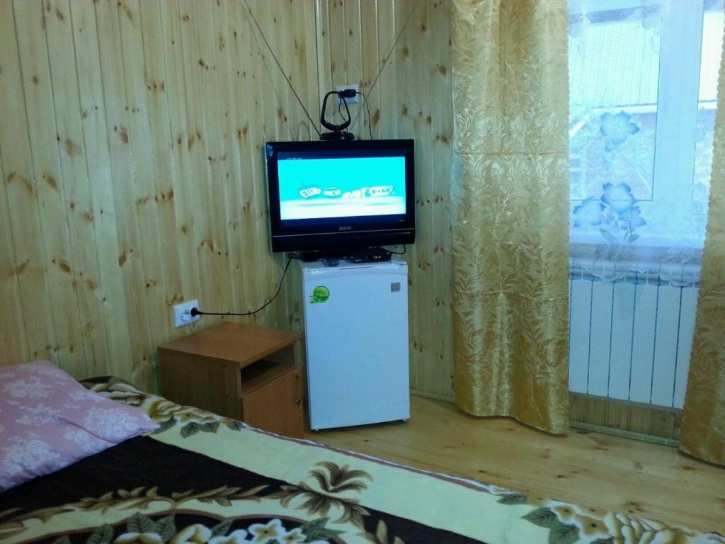 "A television and/or entertainment center at Адыгея""Хаджохский отдых"""