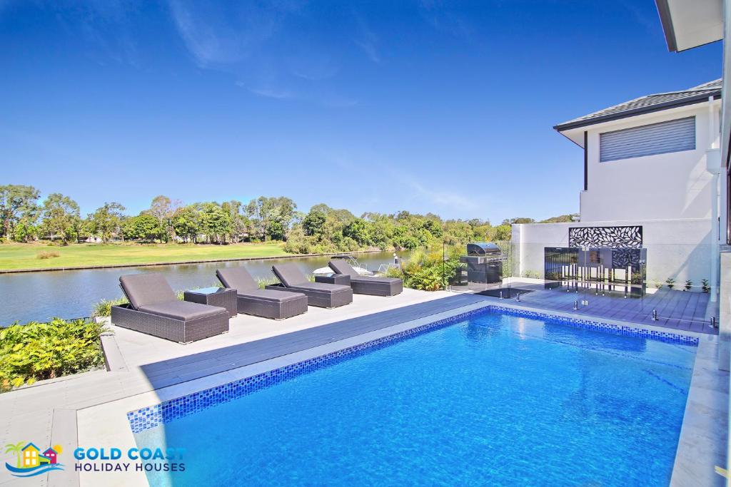 The swimming pool at or near Rejuvenation @ Hope Island Resort