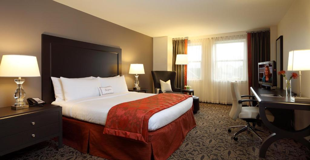 A bed or beds in a room at Georgetown University Hotel and Conference Center