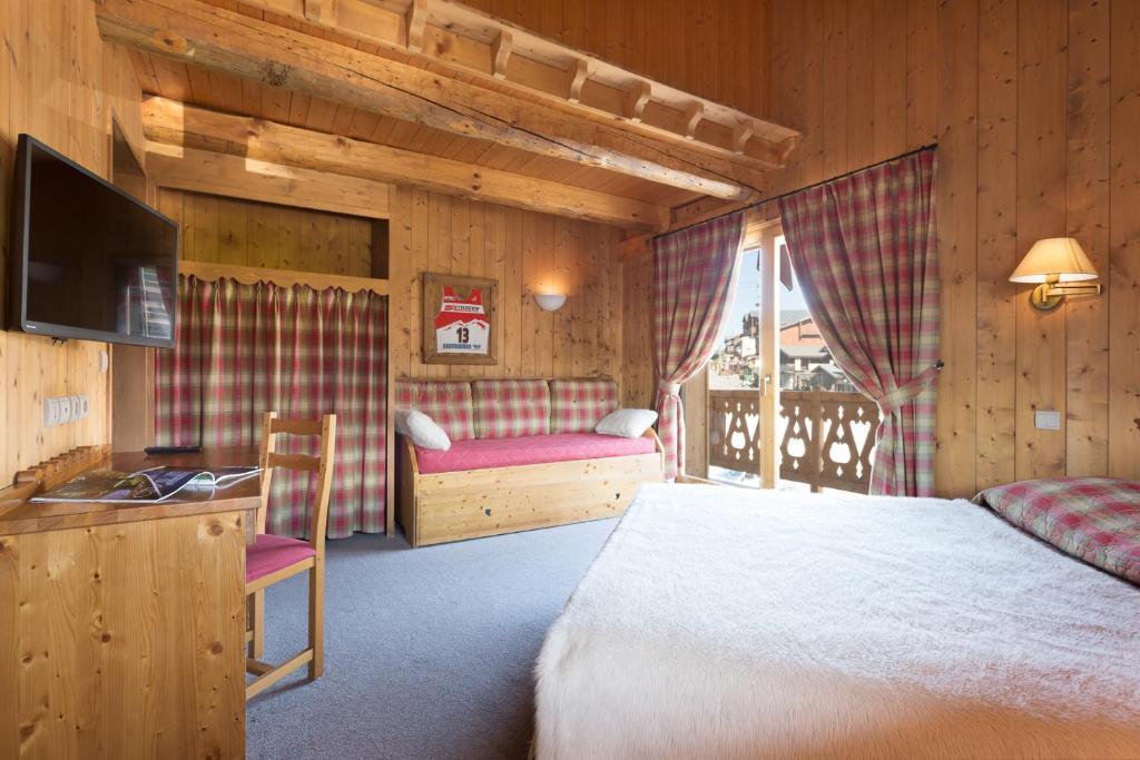Un ou plusieurs lits dans un hébergement de l'établissement Le Chalet d'Eléonore
