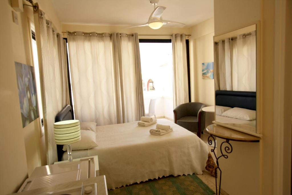 A bed or beds in a room at Pissouri Village Studios
