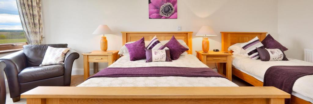 A bed or beds in a room at Peggyslea Farm B&B