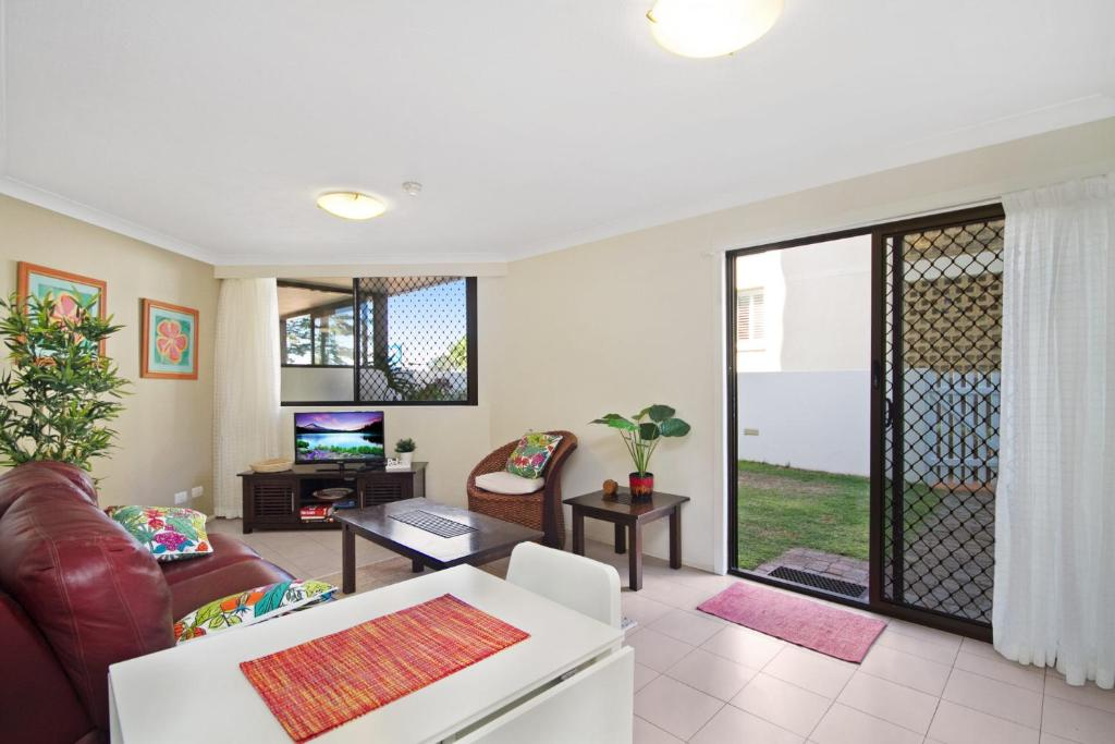 A seating area at Bayview Apartments Unit GA - Ground floor beachfront unit with private courtyard