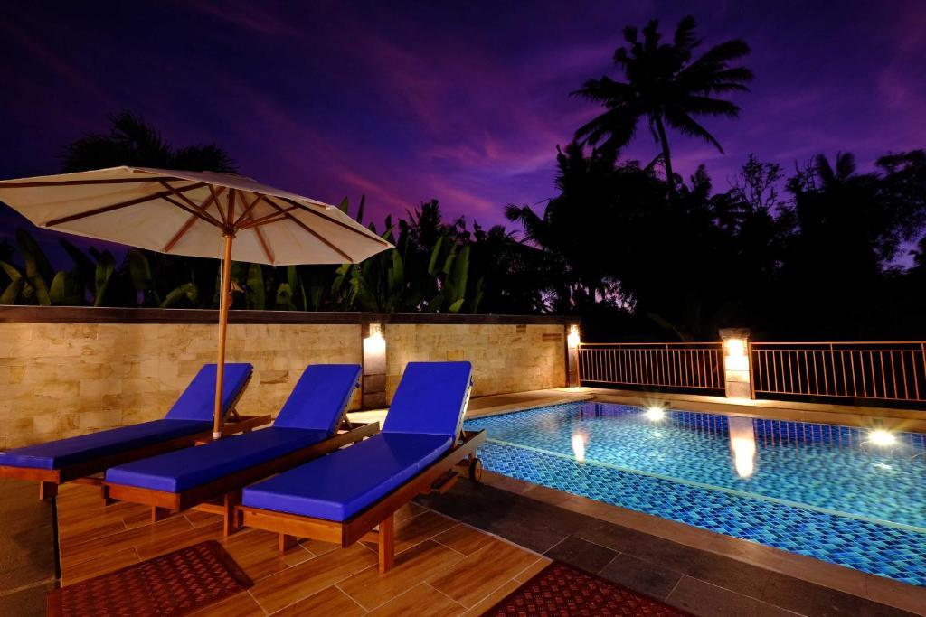 The swimming pool at or near Sari Villa Ubud
