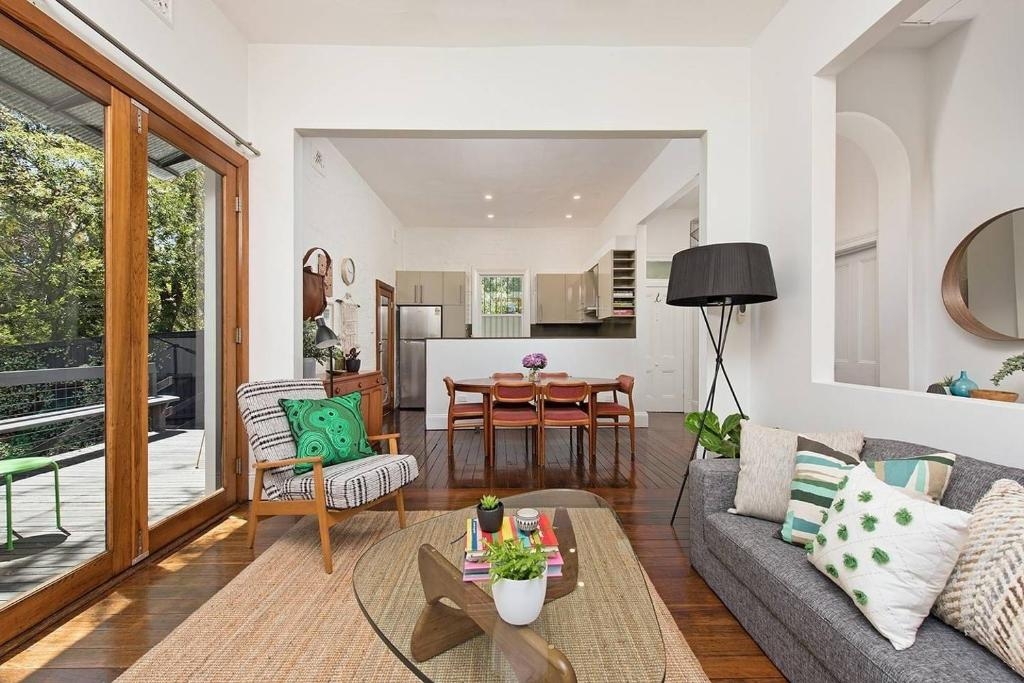 A seating area at Historic 1890s House With Terraced Backyard Deck
