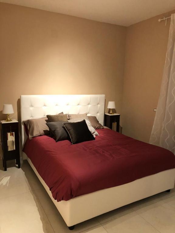 Un pat sau paturi într-o cameră la B&b Panoramica 33