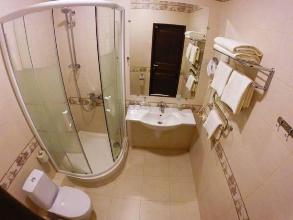 Ванная комната в Отель Тепло