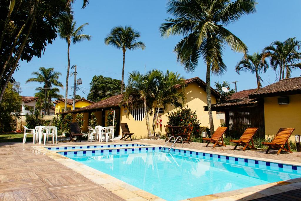 The swimming pool at or near Arco Iris Chalés I