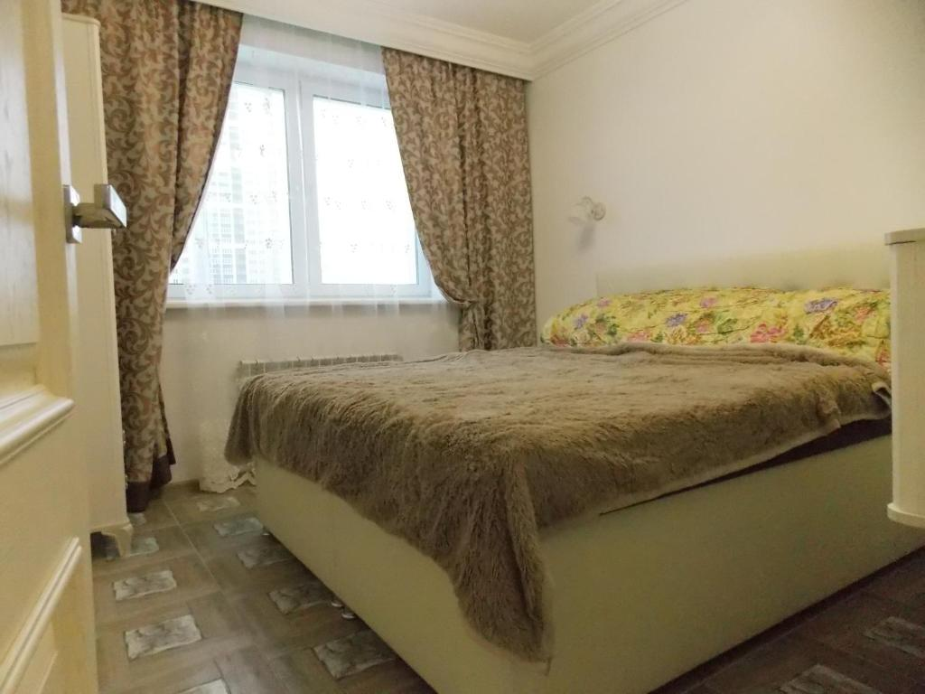 A bed or beds in a room at Апартаменты люкс на Носовыхинском шоссе