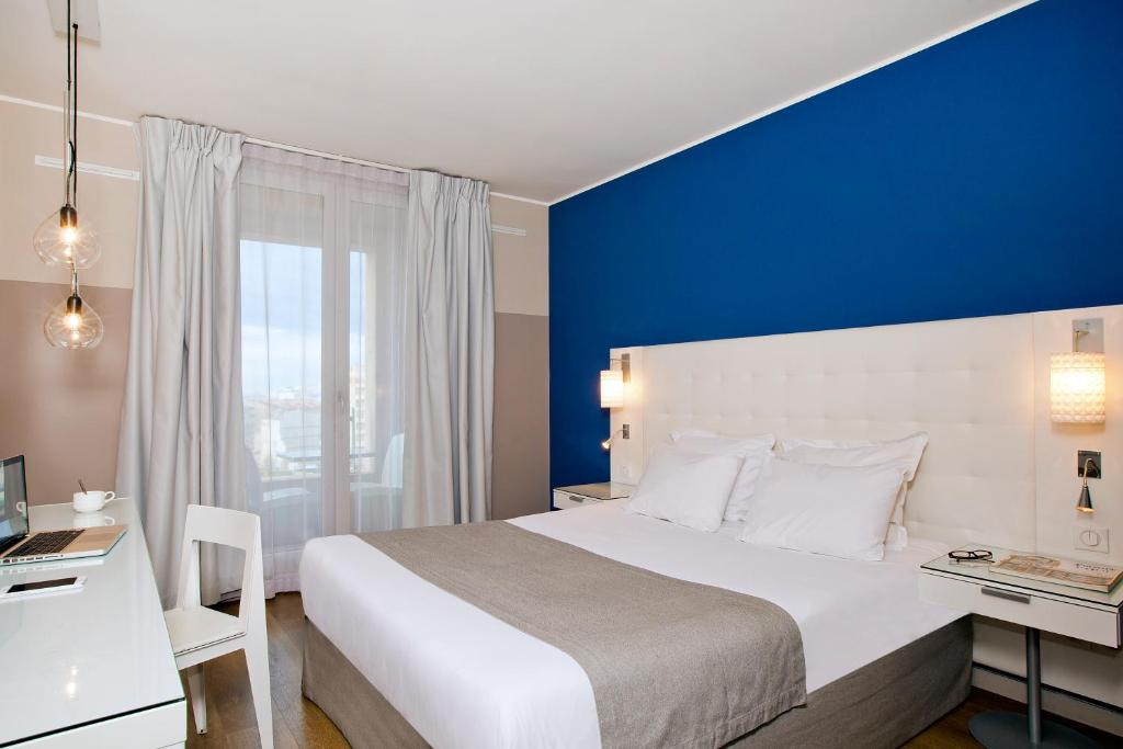 A bed or beds in a room at Residhome Marseille Saint-Charles