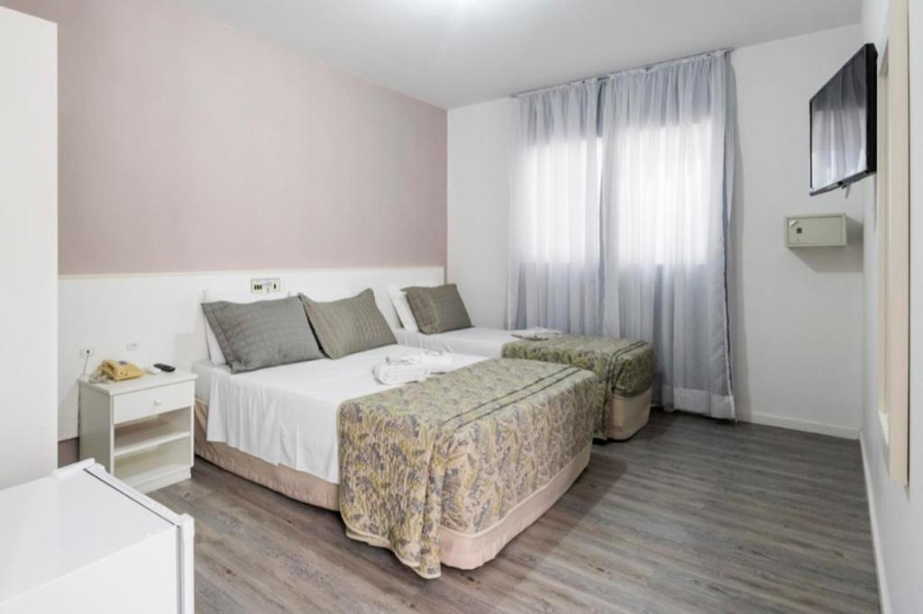 A bed or beds in a room at Hotel Negrini