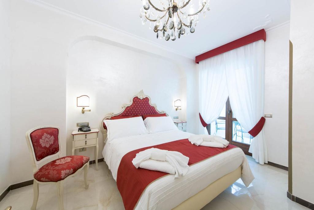 Letto o letti in una camera di B&B Palazzo Montesanto