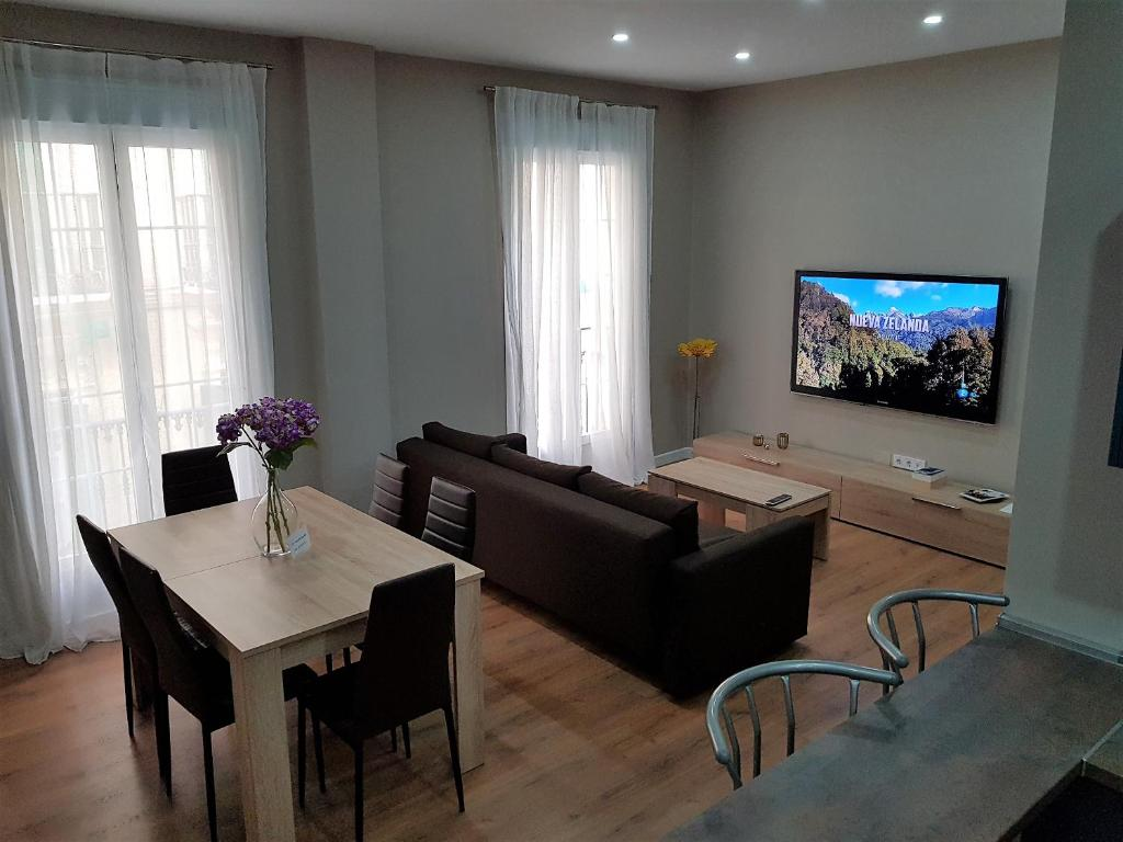 A television and/or entertainment center at DREAMSUITES MARIN GARCIA.