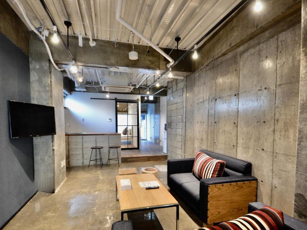 A seating area at 1/3rd Residence Serviced Apartments Akihabara