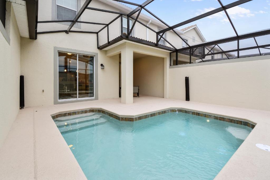 The swimming pool at or close to Four Bedrooms w/ Pool TownHome 4841