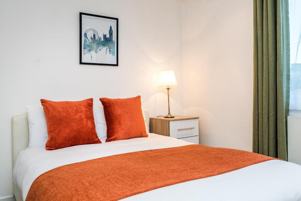 A bed or beds in a room at City View House