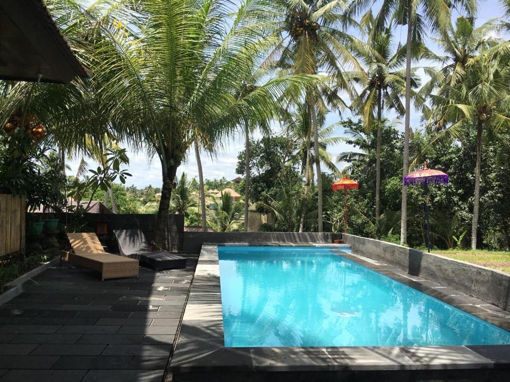 The swimming pool at or near Semanggi Cottage