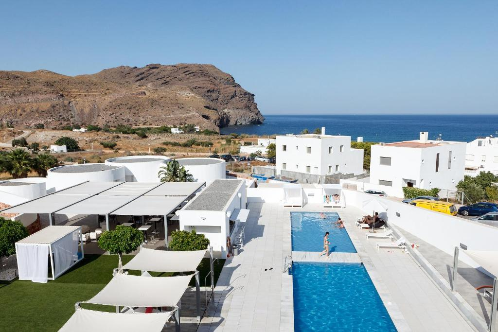A view of the pool at Hotel Spa Calagrande Cabo de Gata or nearby
