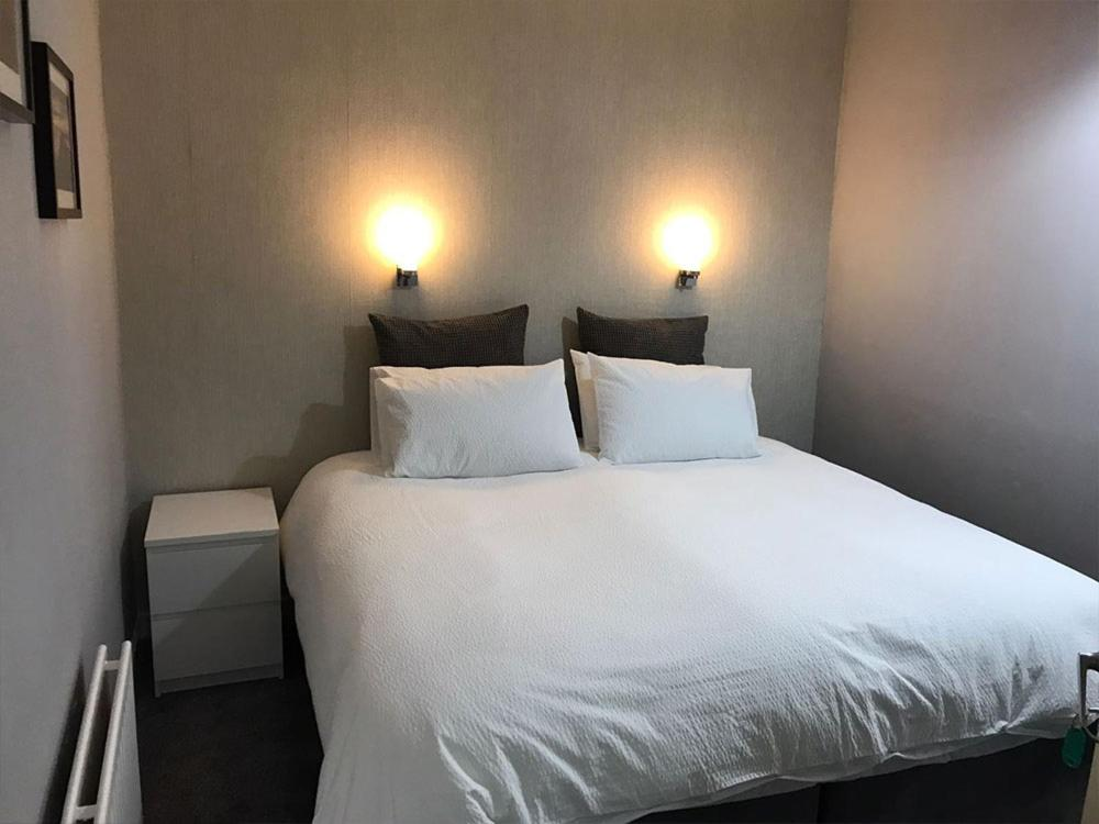 A bed or beds in a room at The Waverley Hotel Whitehaven
