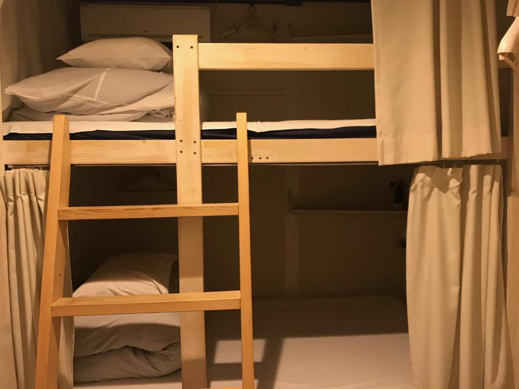A bunk bed or bunk beds in a room at 328 Hostel & Lounge