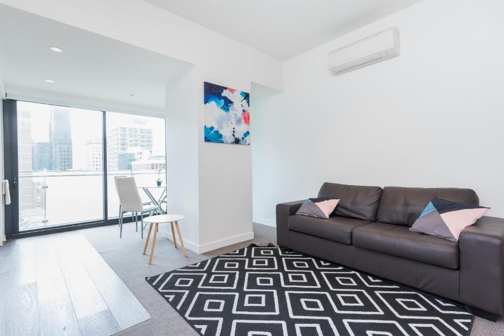 A seating area at Relax in Luxury & Modern MELB 1BD