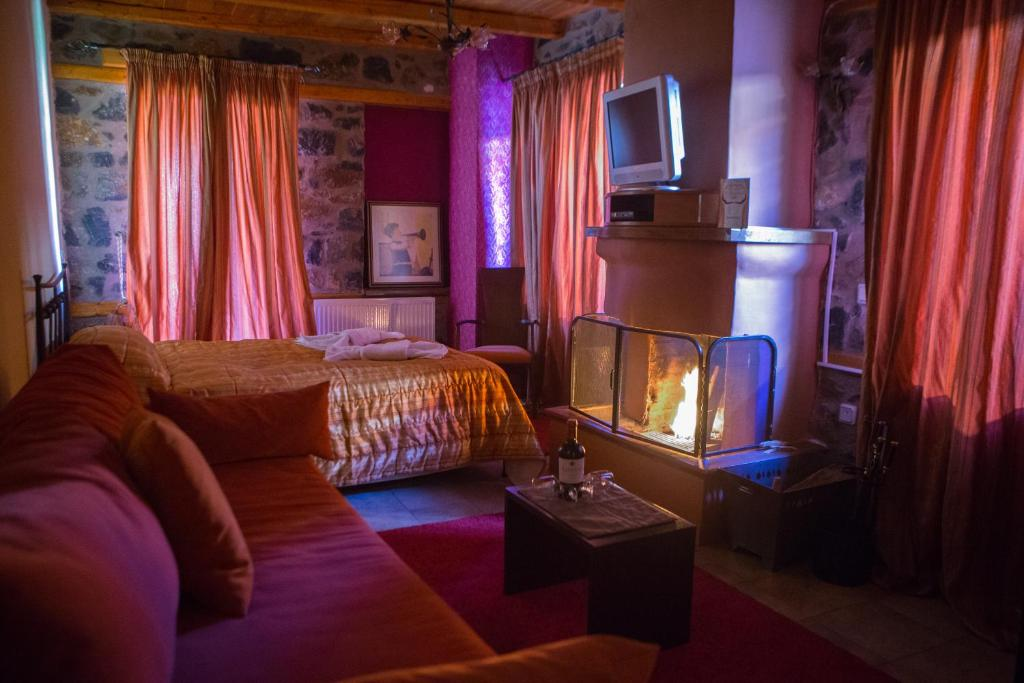 Ένα ή περισσότερα κρεβάτια σε δωμάτιο στο To Spitiko