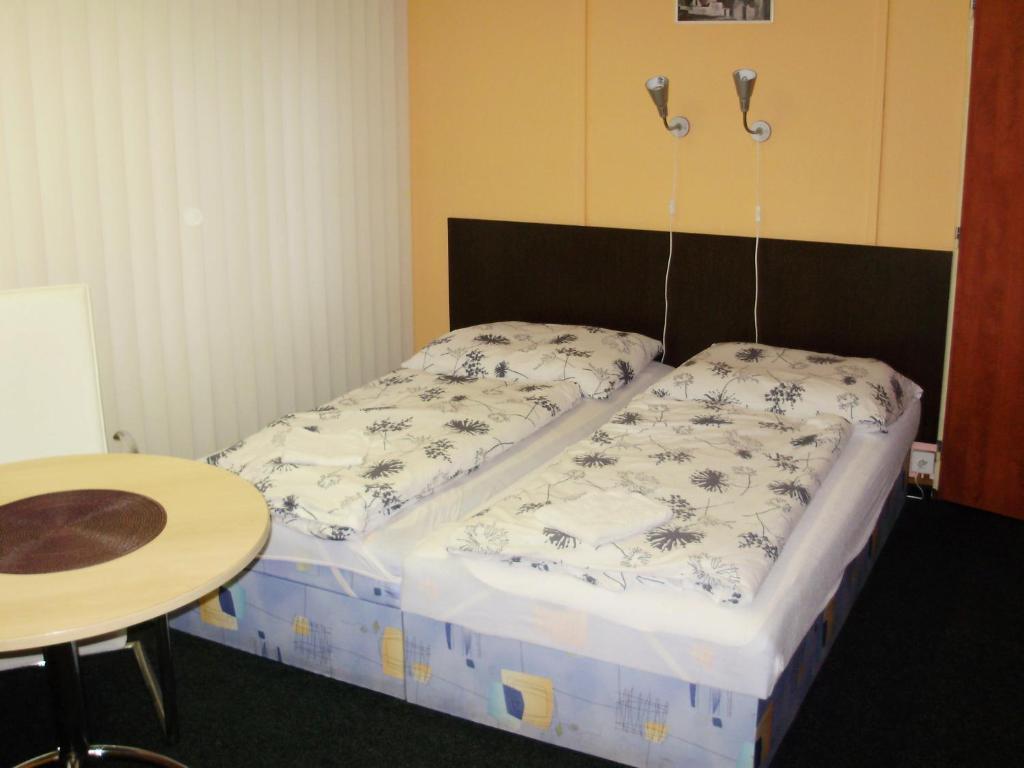 Postel nebo postele na pokoji v ubytování Penzion U Remízky