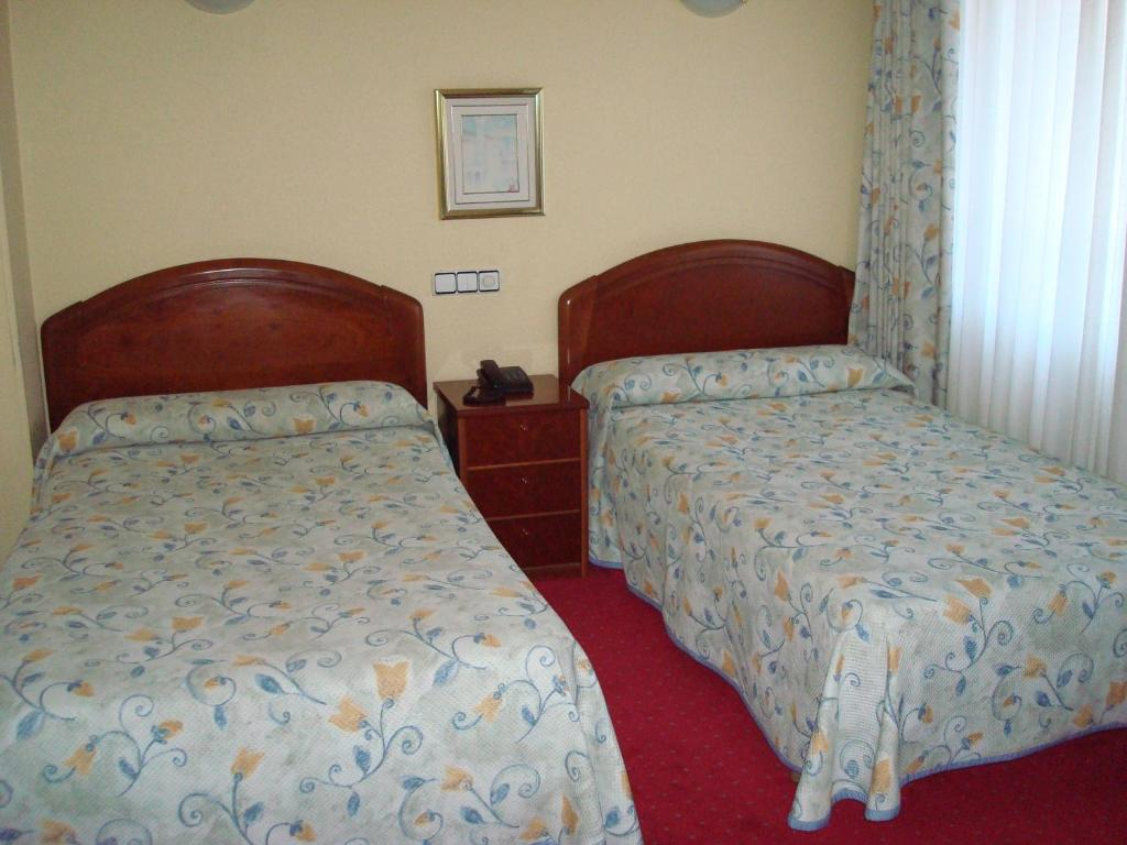 A bed or beds in a room at Hotel Estadio