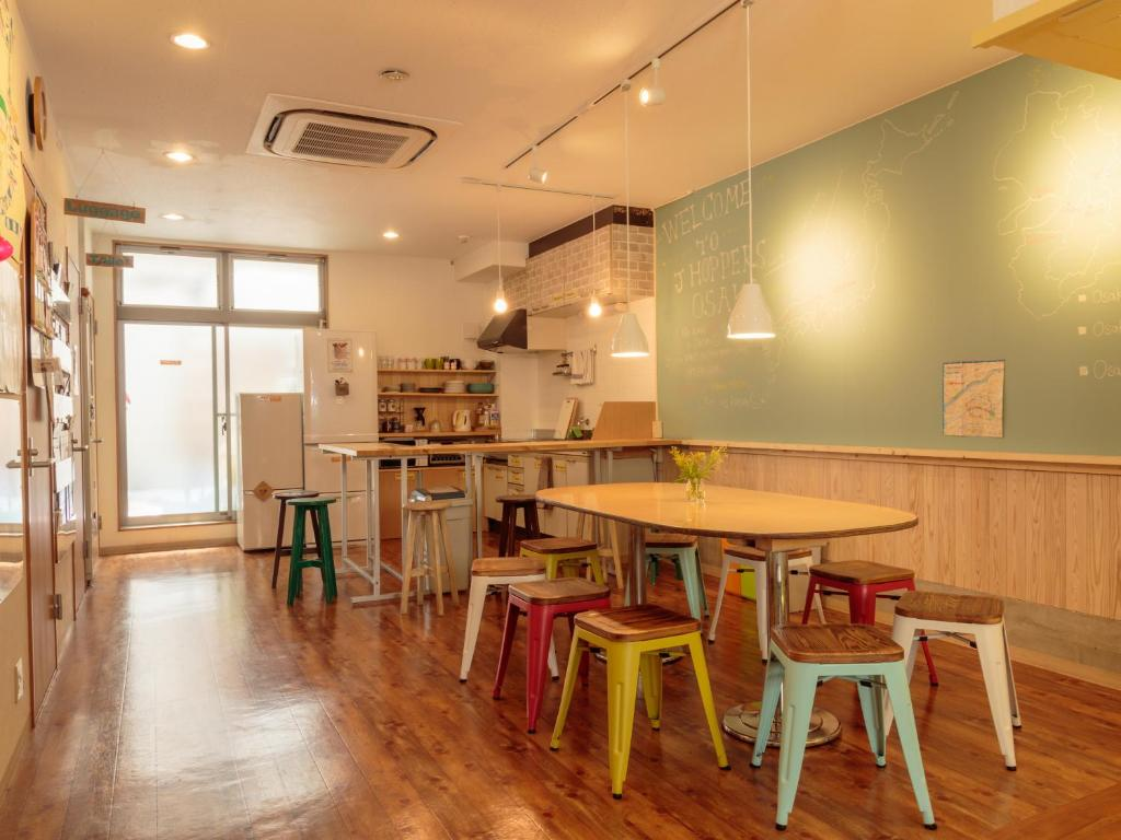 A restaurant or other place to eat at J-Hoppers Osaka Guesthouse