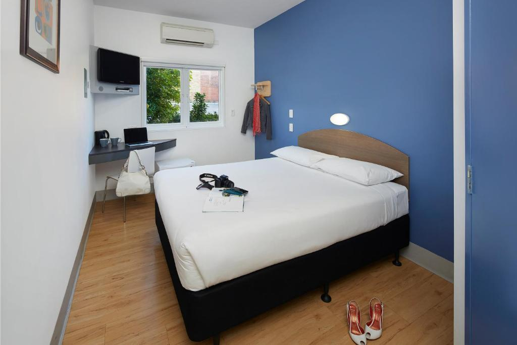 A bed or beds in a room at ibis Budget Perth Airport