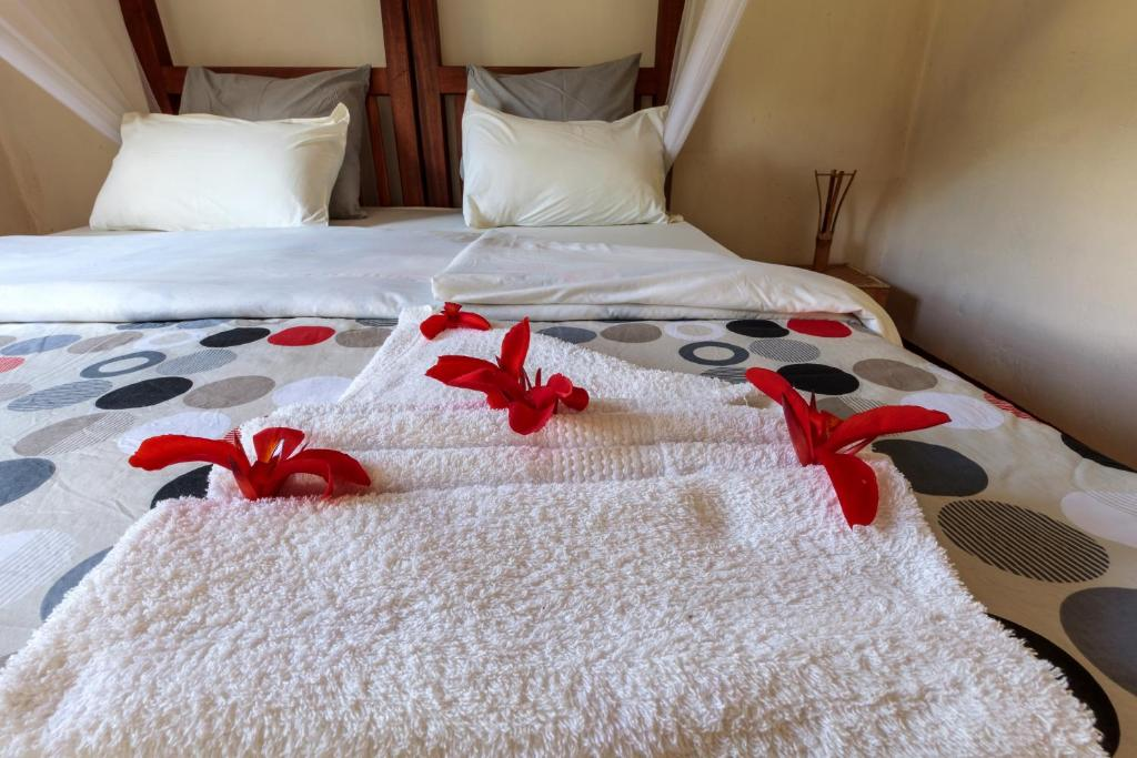 A bed or beds in a room at Gorilla Valley Lodge