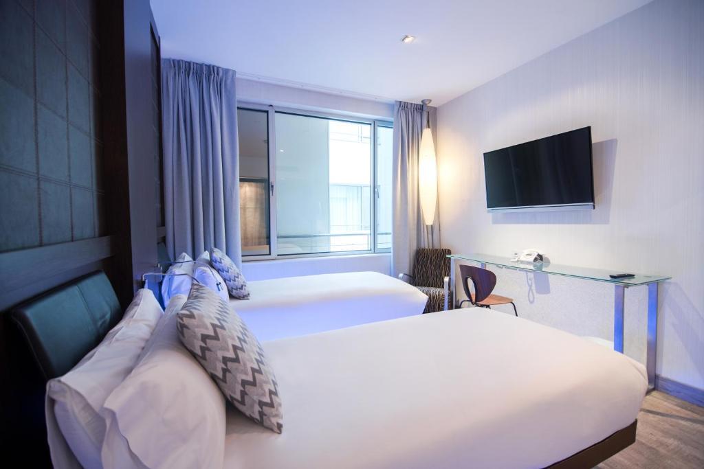 Cama o camas de una habitación en Petit Palace President Castellana