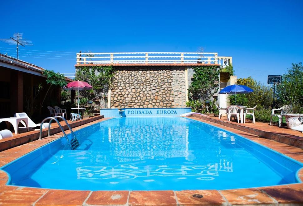 A piscina localizada em Pousada Europa ou nos arredores