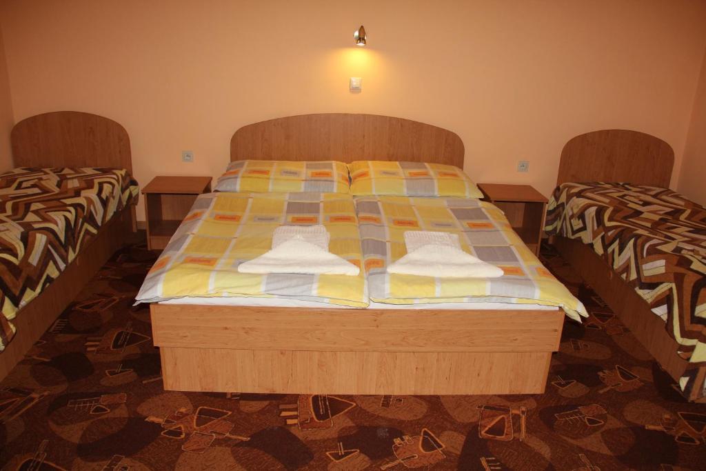 Postel nebo postele na pokoji v ubytování U Mami