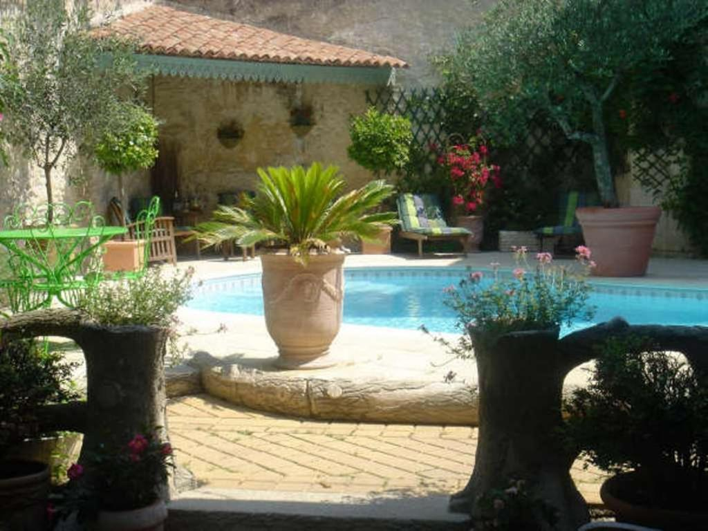 The swimming pool at or near B&B Maison Gaudin
