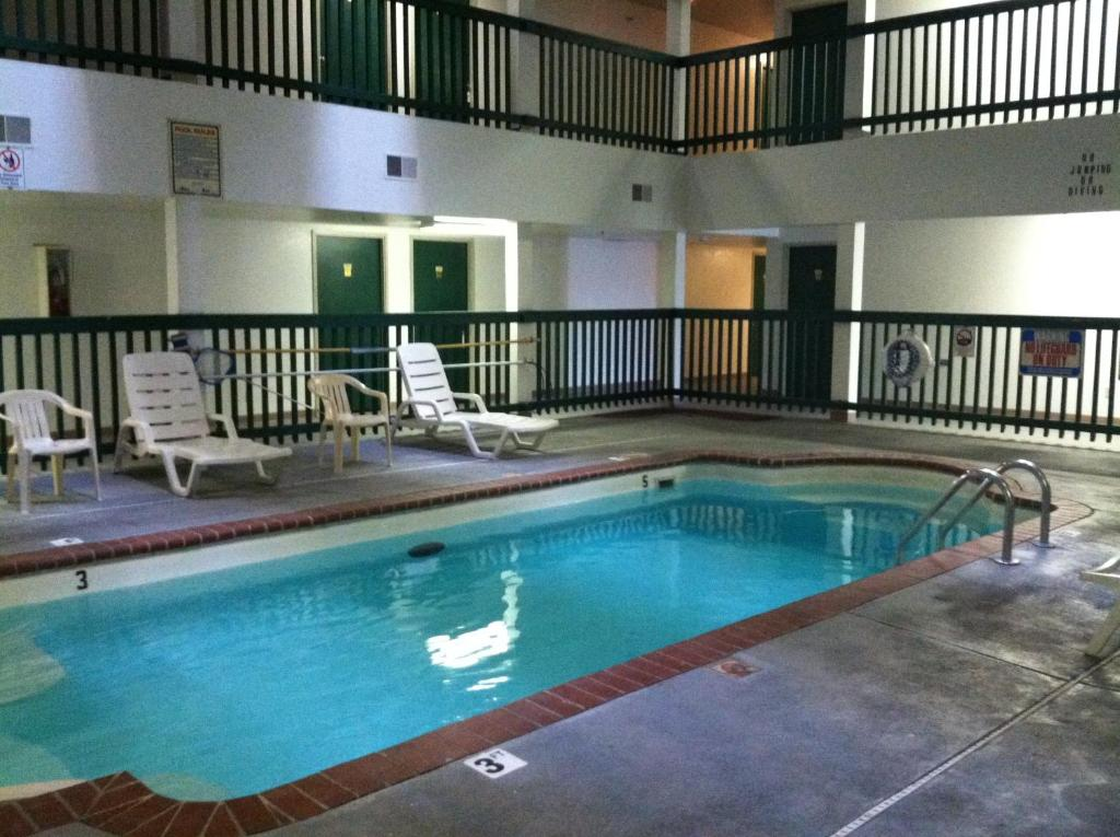 The swimming pool at or near Budget Inn Wentzville