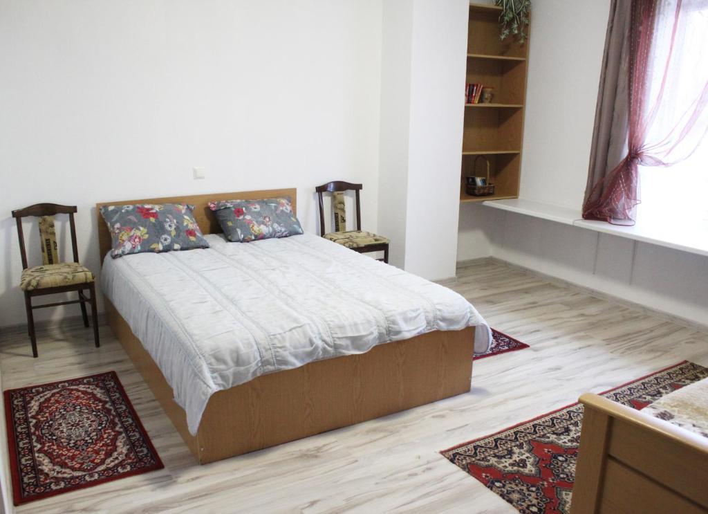 Кровать или кровати в номере Alida Guest House