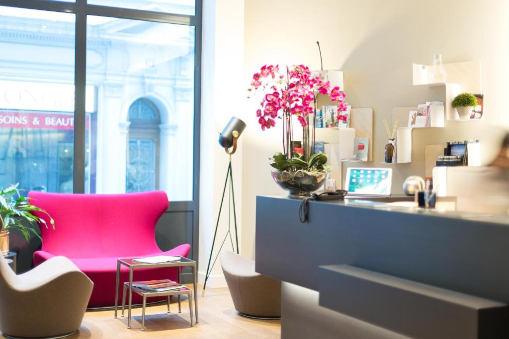 Lobby/Rezeption in der Unterkunft Hôtel des Voyageurs Boutique