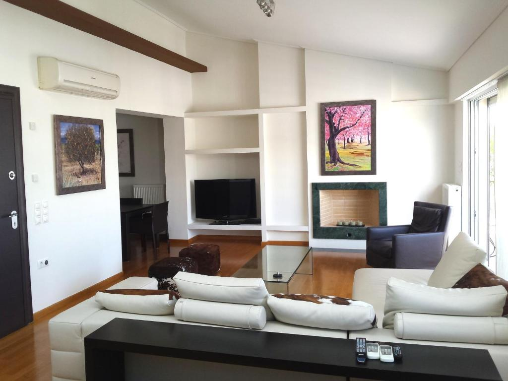 A seating area at Elvita Athens Sea View Maisonette